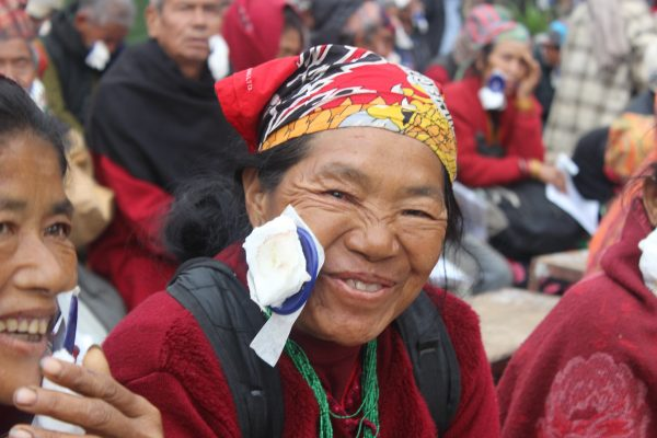 Woman removing bandage for the first time after cataract surgery (Nuwakot District, Nepal)