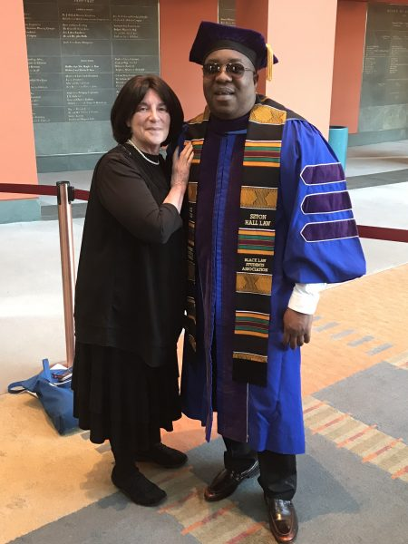 Lavelle's Scholarship Coordinator, Joan Dulitz, and a Lavelle-Brother Kearney scholar at his graduation from Seton Hall University Law School