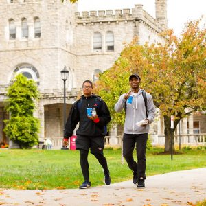 2 students walking on the quad