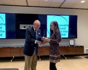 Scholar receiving certificate