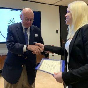 photo of Scholar receiving a certificate