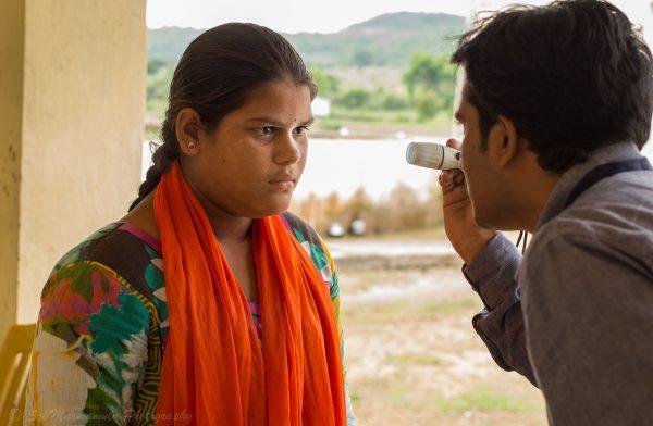 Girl receiving eye exam