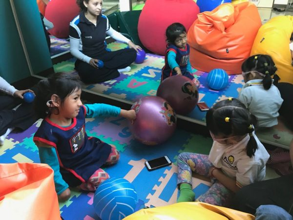 children sitting on the floor during educational playtime
